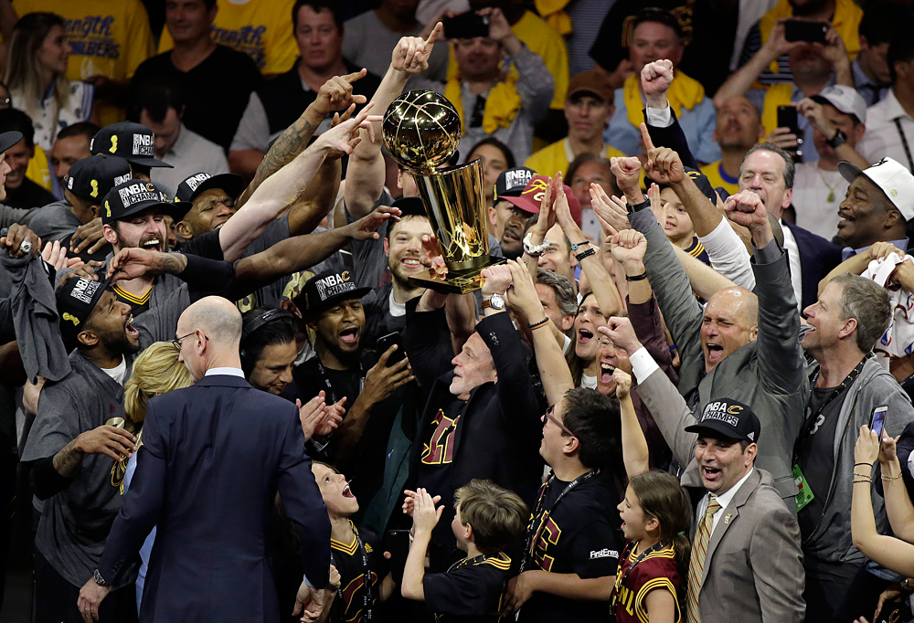 Cleveland Cavaliers players and staff celebrate after Game 7 of basketball's NBA Finals between the Golden State Warriors and the Cavaliers in Oakland, Calif., Sunday, June 19, 2016. The Cavaliers won 93-89.