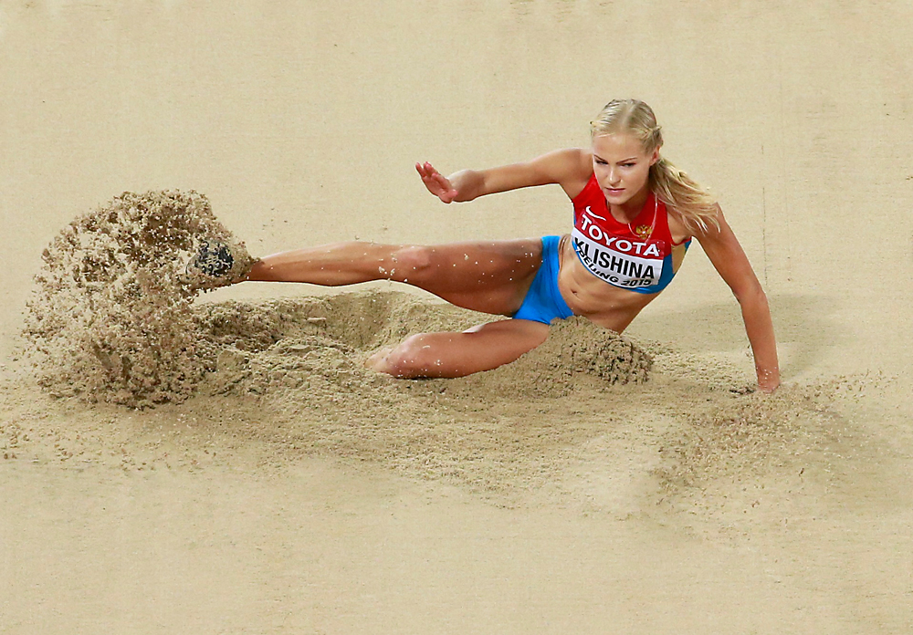 Darya Klishina of Russia competes in the women's long jump final during the 15th IAAF World Championships at the National Stadium in Beijing, China August 28, 2015.