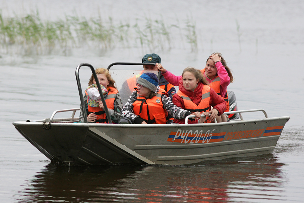 Kids return to the Syamozero Park Hotel in the Pryazhinsky District. At least 13 children from Moscow died in the early hours of June 19 as storm hit a tourist boat on Lake Syamozero.