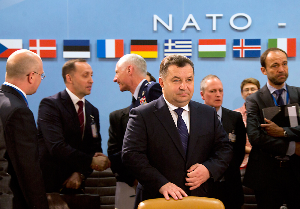 Ukraine's Defense Minister Stepan Poltorak, center, waits for the start of a meeting of the NATO-Ukraine Commission at NATO headquarters in Brussels, June 15, 2016.