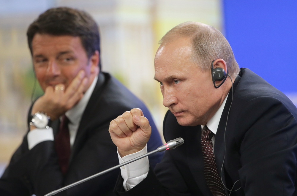 Italy's Prime Minister Matteo Renzi and Russia's President Vladimir Putin give a joint news conference following their talks on the sidelines of the 2016 St. Petersburg International Economic Forum, June 17, 2016.