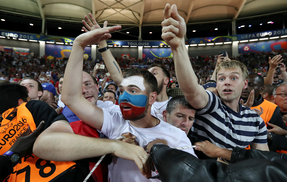 Russian supporters are pushed back as they shout at their team after Russia lost the Euro 2016 Group B soccer match between Russia and Wales at the Stadium municipal in Toulouse, France, June 20, 2016.
