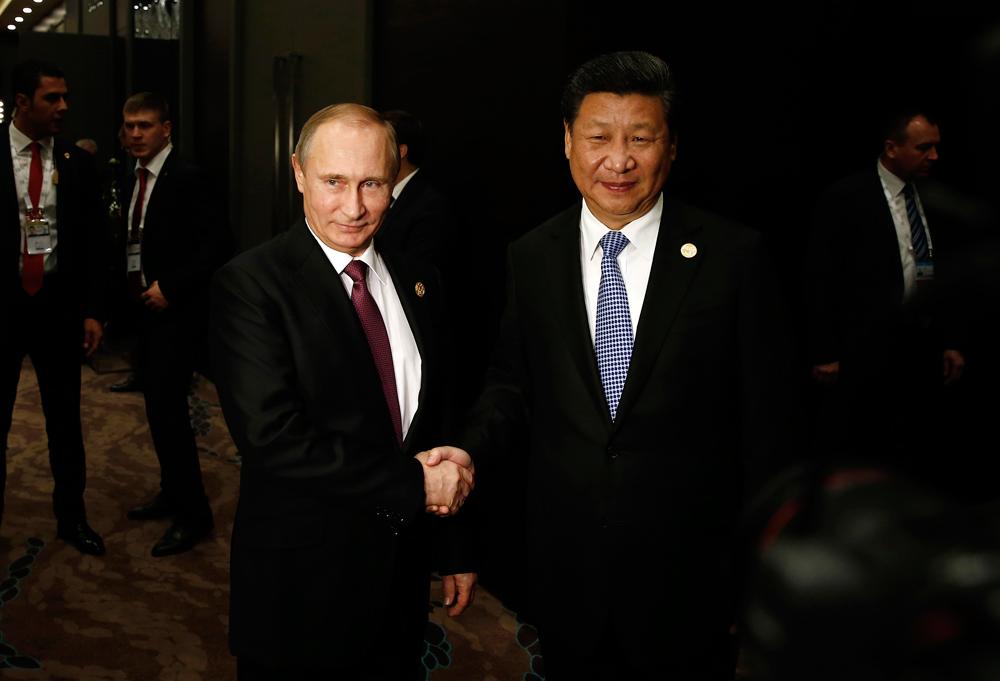 Presiden Rusia Vladimir Putin (kiri) dan Presiden Tiongkok Xi Jinping.