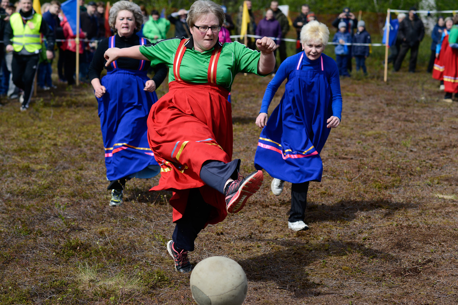 The contests include jumping through wooden sledges, crossbow shooting, lassoing ferrets, running with a stick on uneven terrain, rowing, and Saami football.