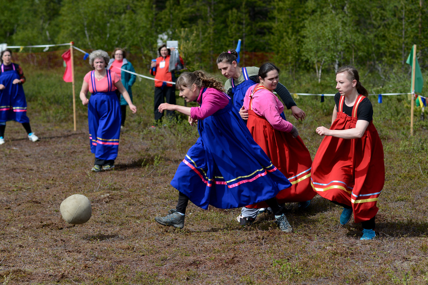 "This year female residents of Murmansk, Olenegorsk, and the settlement of Revda came to ""drive the ball through the swamp."""