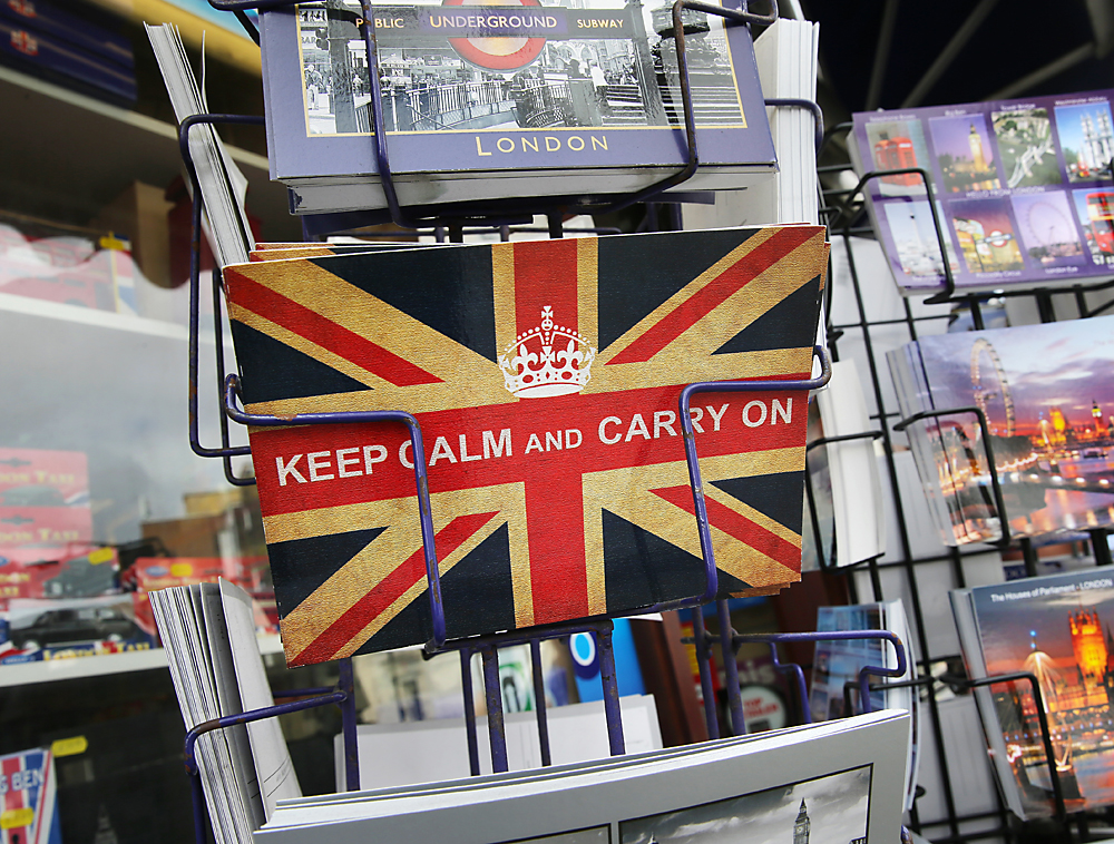 A postcard reads 'Keep calm and carry on' in London, Britain, 24 June 2016. In a referendum on 23 June, Britons have voted by a narrow margin to leave the European Union (EU)