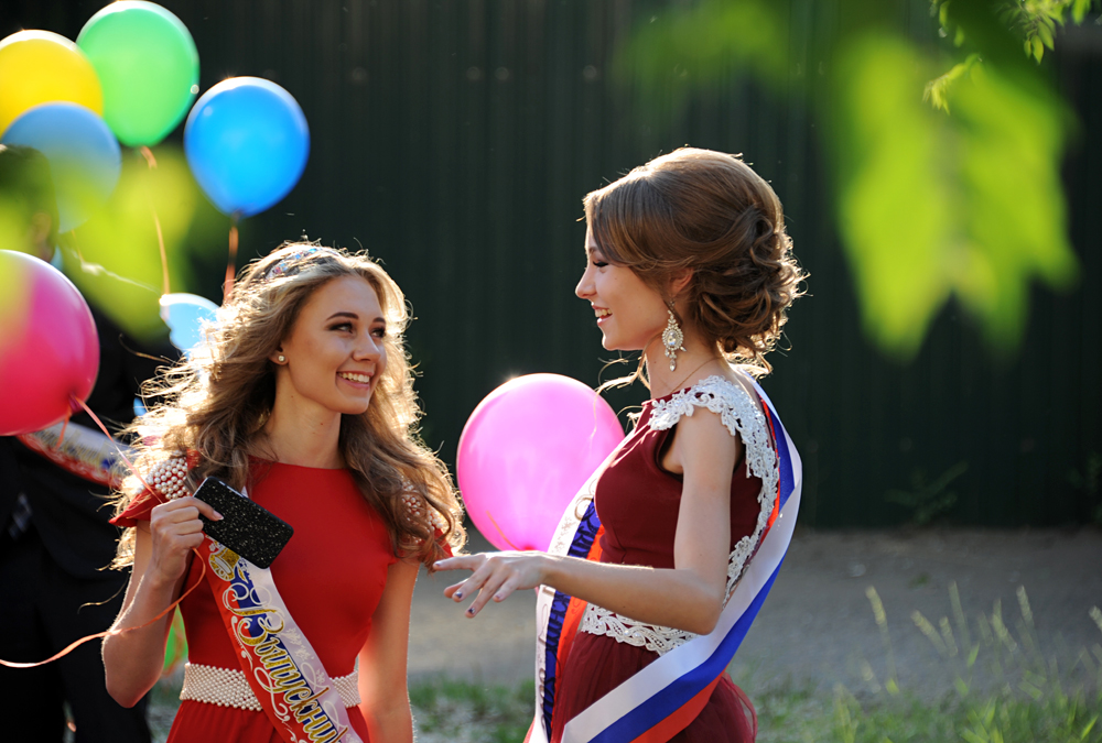School-leavers walk in Chita as they celebrate graduation.