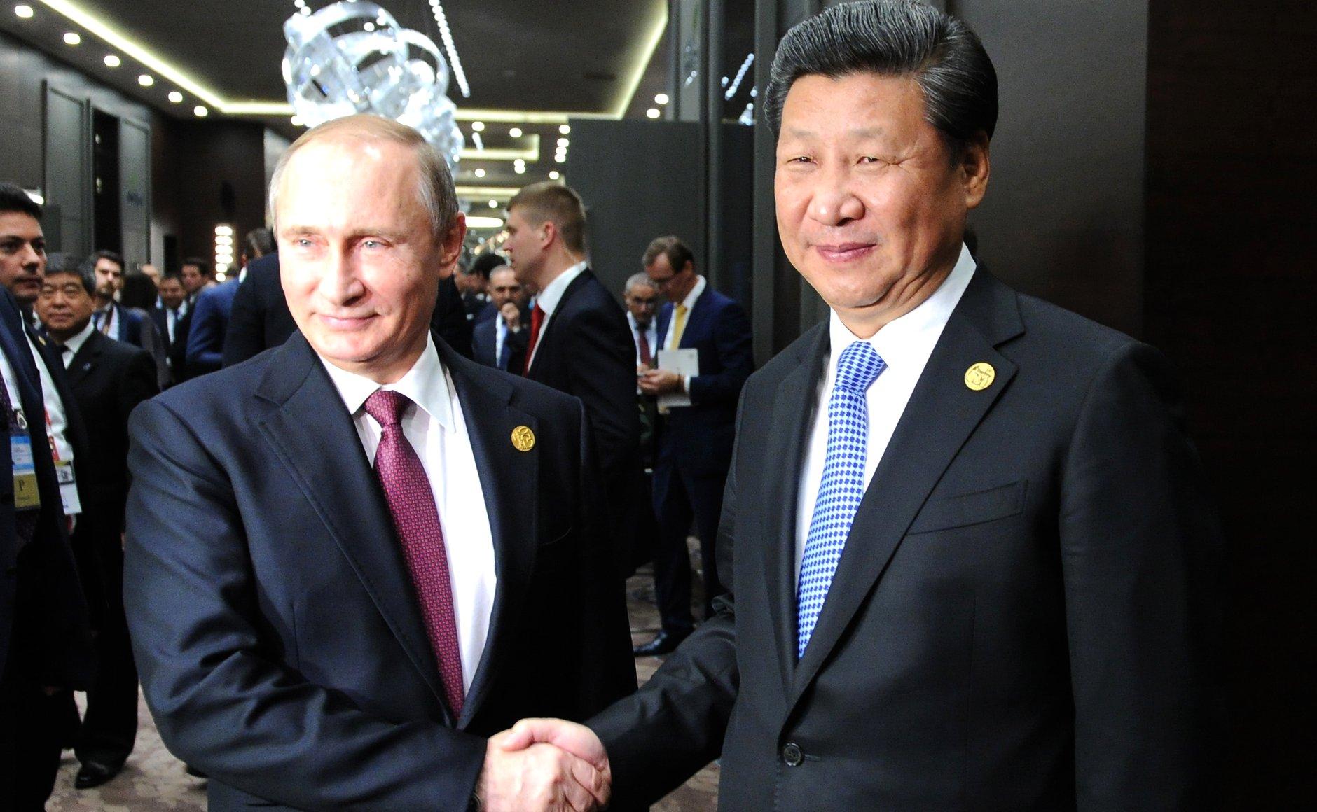 Russian President Vladimir Putin (L) and Chinese President Xi Jinping (R), November, 2015
