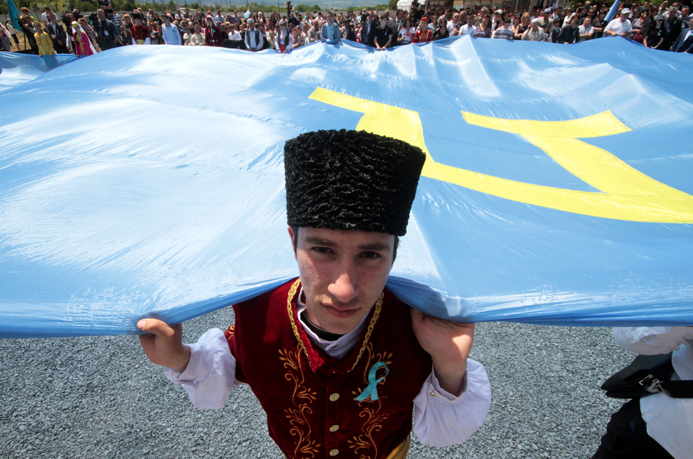 People gather to commemorate the anniversary of the deportation of Crimean Tatars from Crimea to Central Asia in 1944, in Bakhchysarai district of Crimea, May 18, 2016.