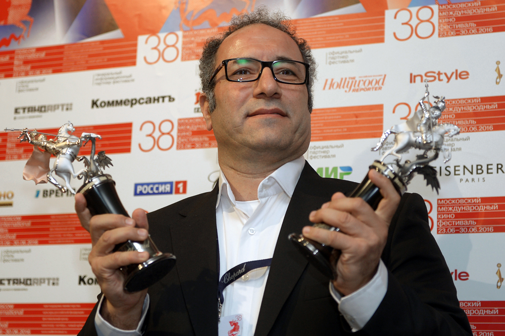 Iranian director Reza Mirkarimi, winner of the Golden George award for his film Daughter, accepts the Best Actor award for Farhad Aslani at the closing of the 38th Moscow International Film Festival.
