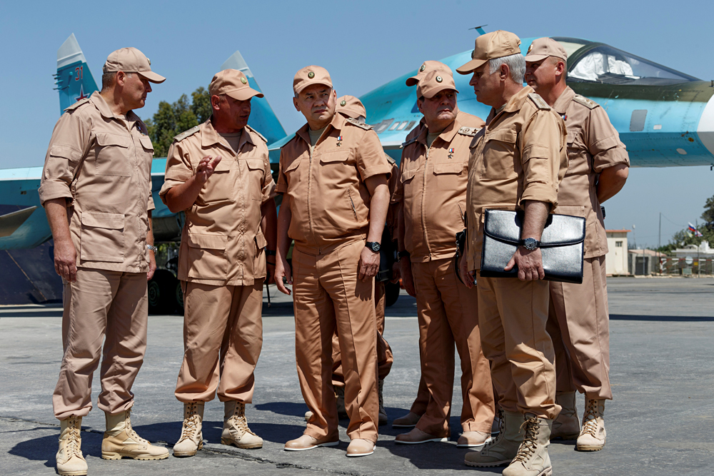 Russian Defence Minister Sergei Shoigu (3rd left) visits Hmeymim air base in Syria, June 18, 2016.