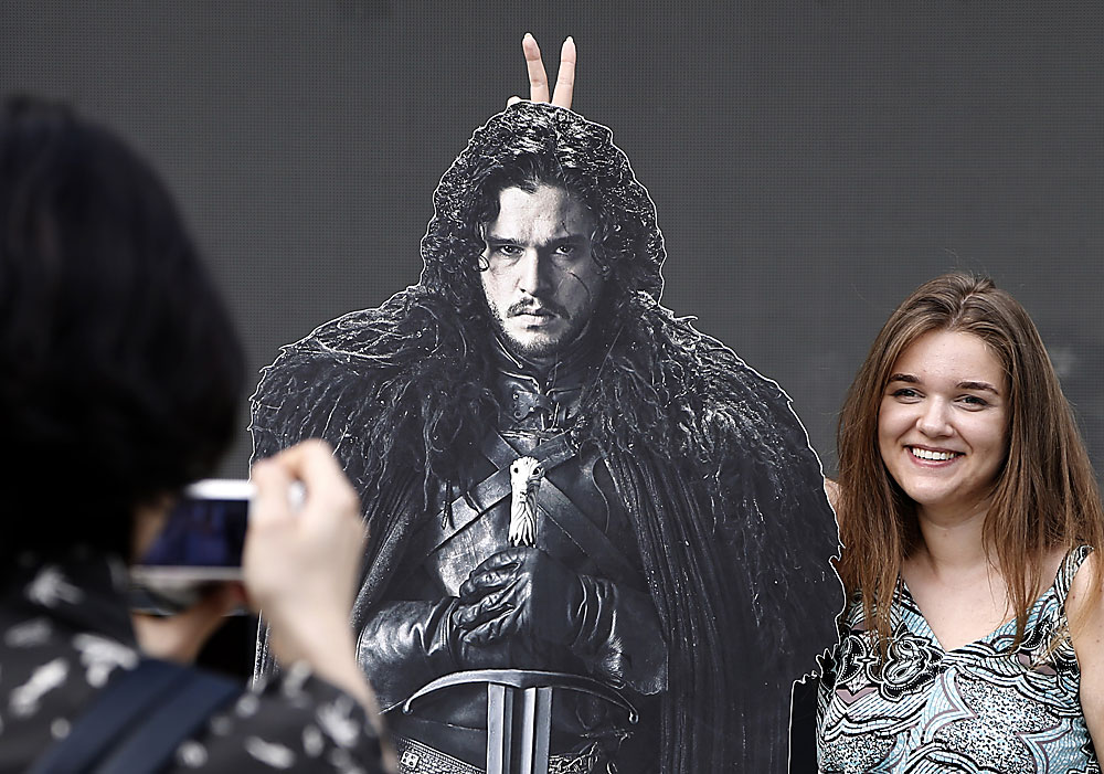 A visitor poses for pictures during the Game of Thrones festival in Moscow, Russia, 02 July 2016. The festival runs one day at Moscow Hermitage Garden.