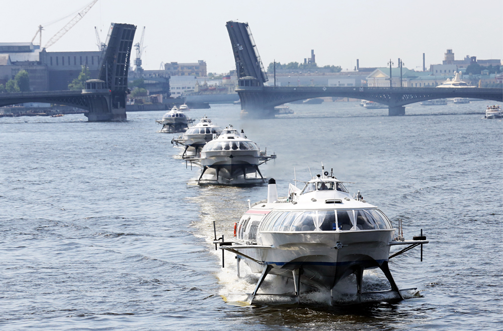 Participants in the River Carnival in St. Petersburg dedicated to the Day of the Sea and River Fleet Personnel.