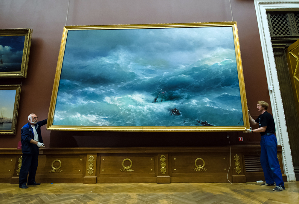 Employees of the Russian Museum in St. Petersburg pack up the works of Ivan Aivazovsky for delivery to the Tretyakov Gallery.