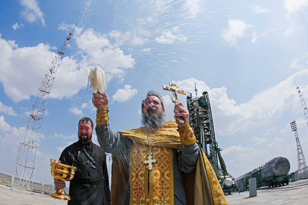 An Orthodox priest conducts a blessing at the launch pad where the Soyuz FG rocket booster and the Soyuz MS-01 spacecraft have been prepared for take off. The launch is scheduled for July 7, 2016 from the Baikonur Cosmodrome in Kazakhstan.