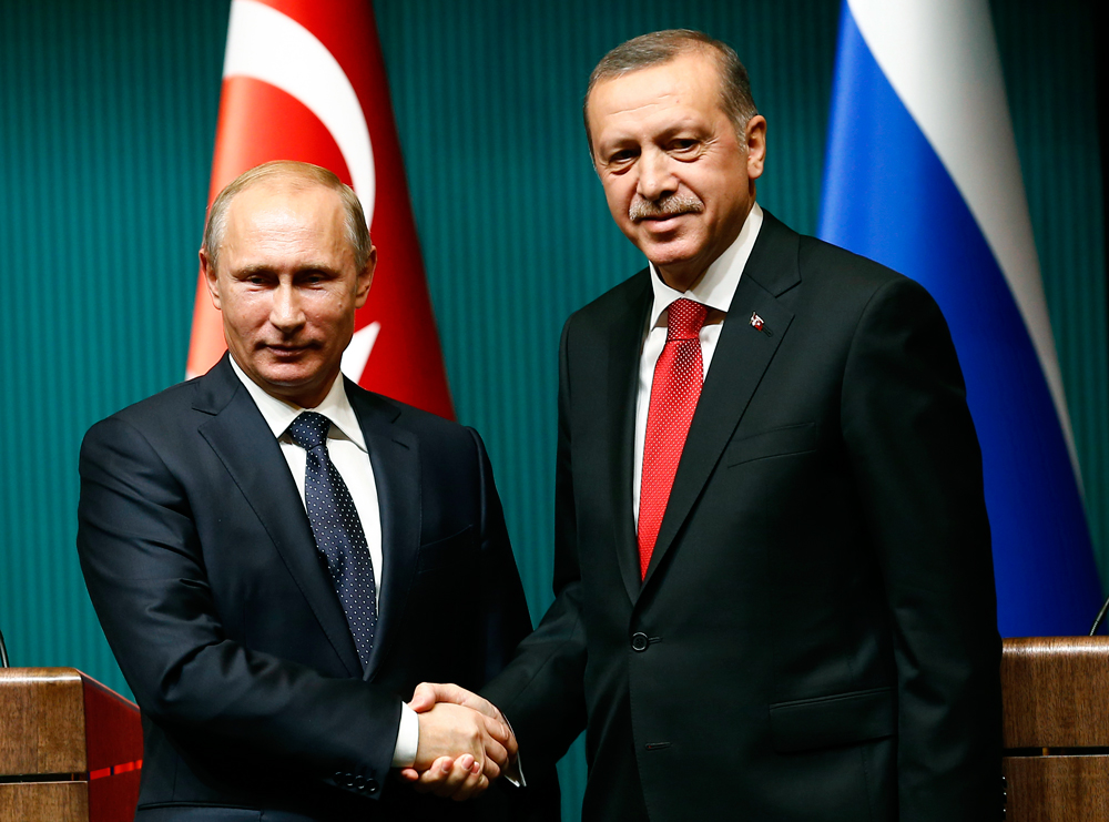 Vladimir Putin shakes hands with Tayyip Erdogan after a news conference at the Presidential Palace in Ankara Dec. 1, 2014.