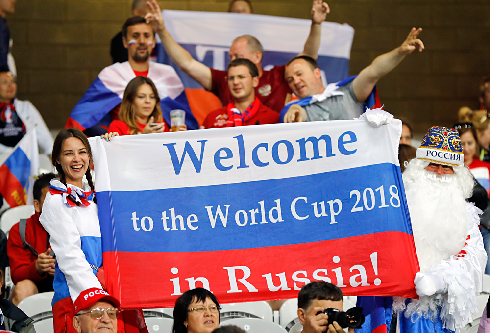 "Russian supporters hold a flag reading ""Welcome to the World Cup 2018 in Russia"" as they wait for the start of the Euro 2016 Group B soccer match between Russia and Slovakia at the Pierre Mauroy stadium in Villeneuve d'Ascq, near Lille, France, on June 15, 2016."