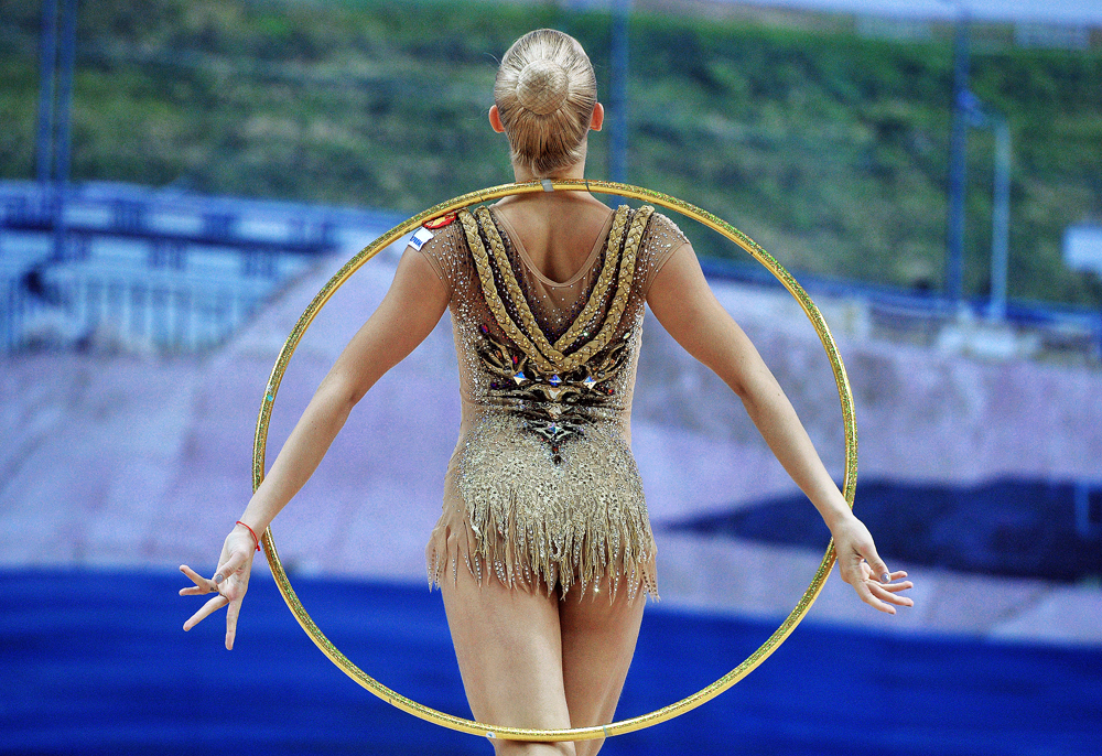 Yana Kudryavtseva of Russia performs her hoop routine during individual all-around at the 2016 Rhythmic Gymnastics World Cup series in Kazan.