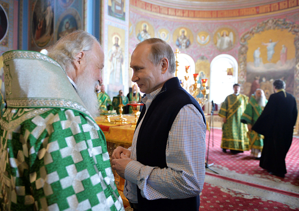 Russian President Vladimir Putin talks with Patriarch of Moscow and All Russia Kirill after a religious service at the Cathedral of the Transfiguration of the Savior at Valaam Monastery, Russia, July 11, 2016.