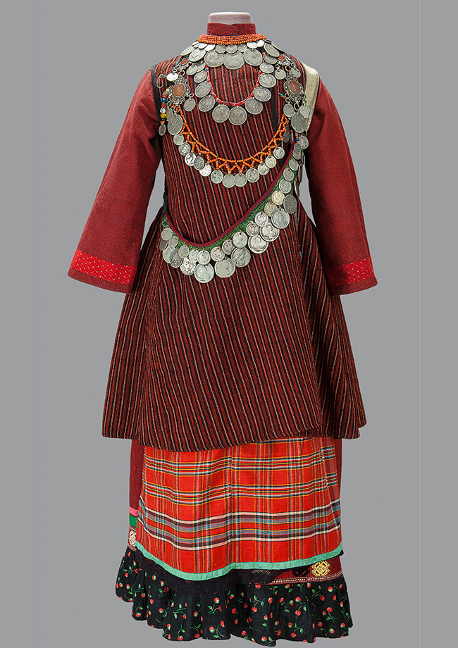 The collection includes examples from the end of the 18th to the 20th centuries, including traditional clothing for people living in the European part of the country. / Female outfit. District of Baltasi, Tatarstan. End of the XIX, beginning of the XX century.