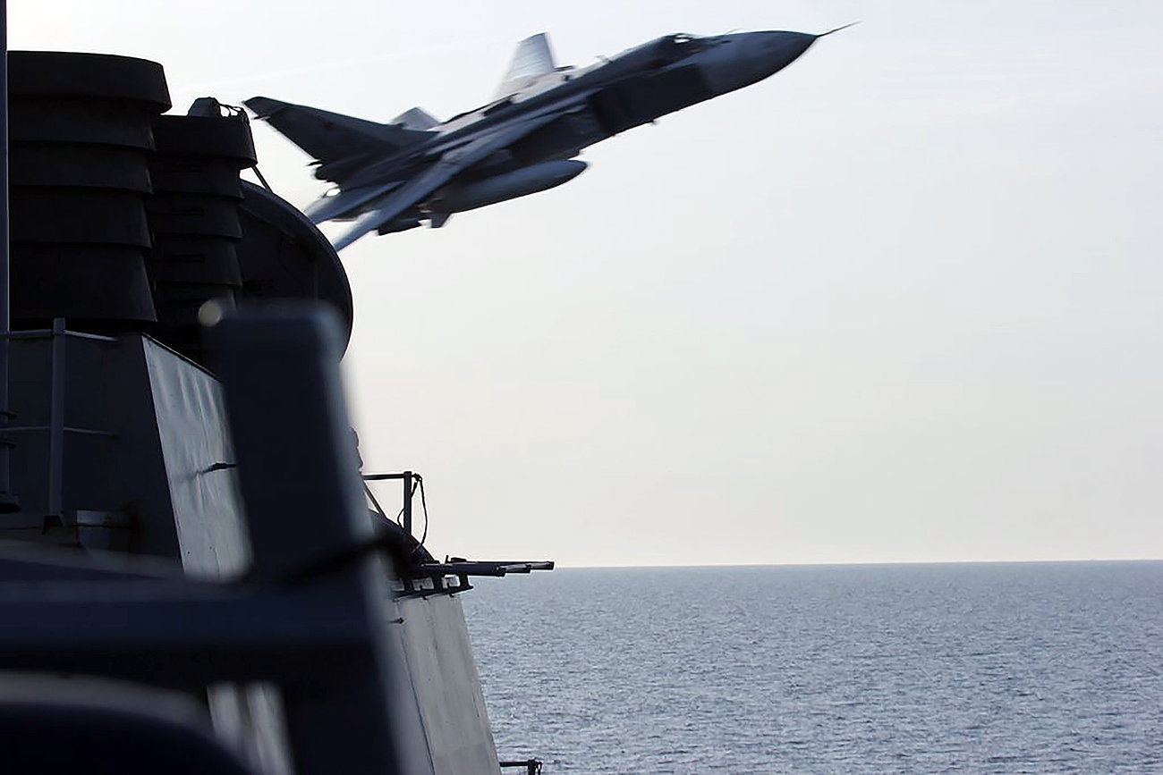 In this photo provided by the U.S. Navy, two Russian Sukhoi Su-24 attack aircraft make a low altitude pass by the U.S.S Donald Cook in the Baltic Sea, April 2016.