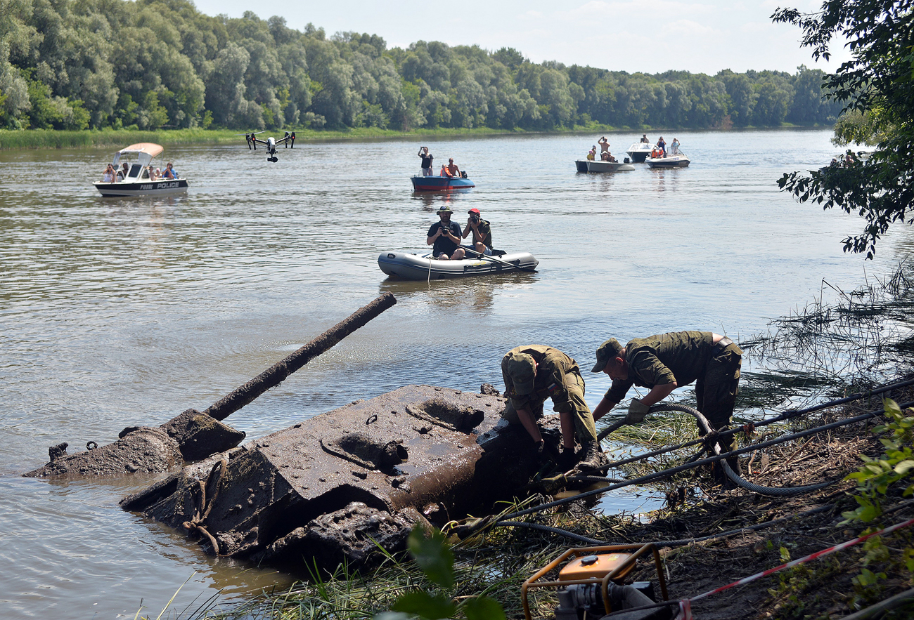 A WWII T-34-76 tank is being pulled from the bottom of the Don River by Patriot Park specialists, servicemen of Russia's Western Military District and divers, July 14, 2016.