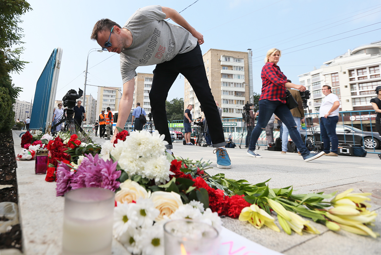 A man lays flowers at the French Embassy in Moscow commemorating victims of the 2016 terror attack in the French resort city of Nice. On 14 July 2016, a truck ploughed into a crowd of people celebrating Bastille Day on the Promenade des Anglais. 84 people were killed in the attack.