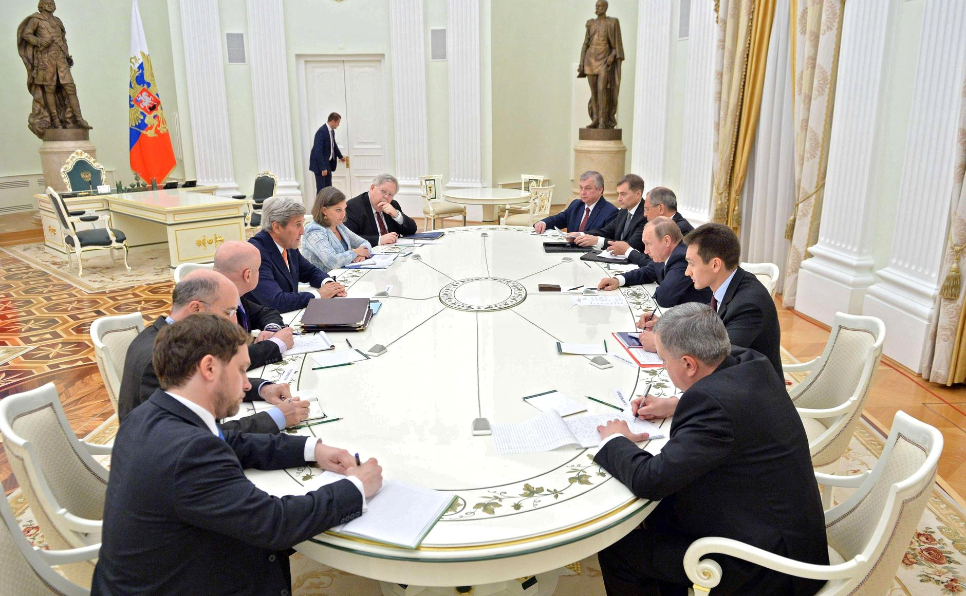 Russian President Vladimir Putin and U.S. Secretary of State John Kerry held talks in Moscow, July 14 evening.