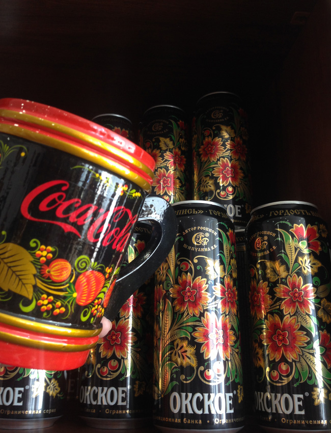 Which do you prefer: a cup with a Coca Cola brand logo or a limited series of beer cans painted with khokhloma?