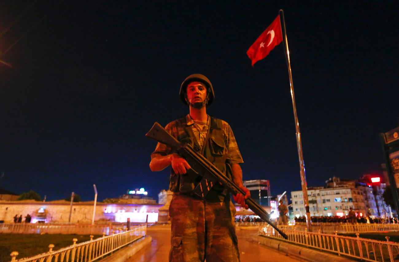 A Turkish military stands guard near the Taksim Square in Istanbul, Turkey, July 15, 2016.