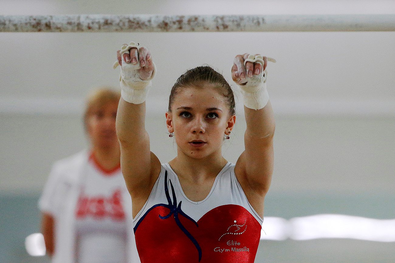 Member of the women's gymnastics Russian Olympic team Evgeniya Shelgunova attends a training session at the Ozero Krugloe (Round Lake) training centre outside Moscow, Russia