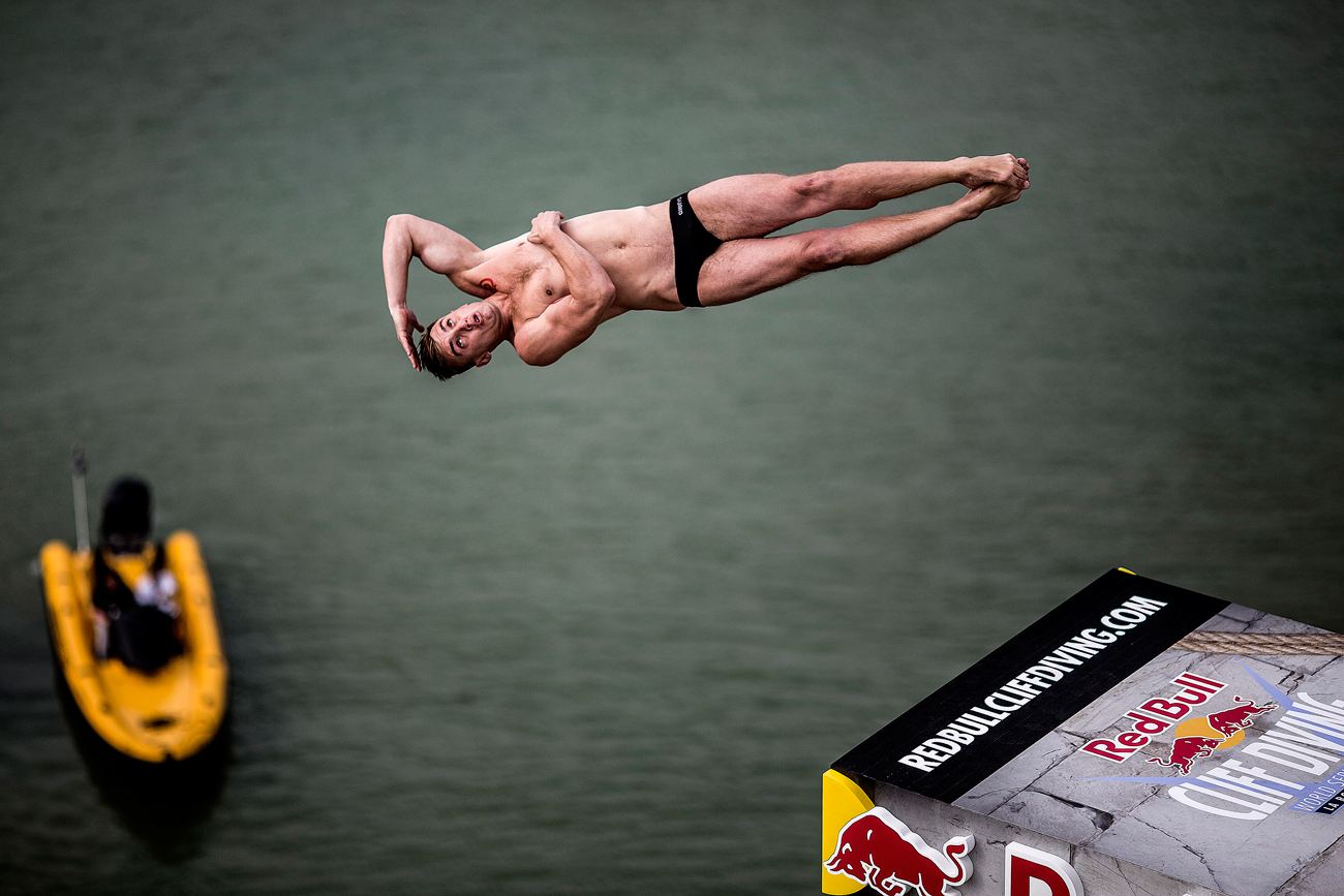 In this handout image provided by Red Bull, Russia's Artem Silchenko dives from the 27 metre platform on the Saint Nicolas Tower during the first training session of the fourth stop of the Red Bull Cliff Diving World Series, La Rochelle, France.