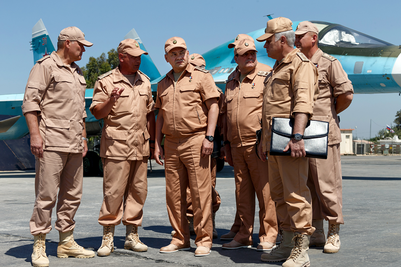 "Dmitry Litovkin: ""The commander's first objective will be to destroy the militants near Palmyra."" Photo: Russian Defense Minister Sergei Shoigu, third left, visits the Hemeimeem air base in Syria, June 18, 2016."