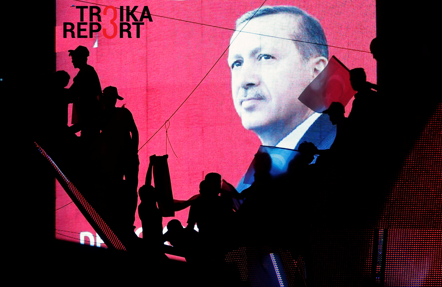 "Vladimir Mikheev: ""Putin set himself in contrast to Western leaders, notably from NATO who turned shy after the failed coup."" Photo: Turkish Supporters are silhouetted against a screen showing President Erdogan during a pro-government demonstration in Ankara on July 17, 2016."