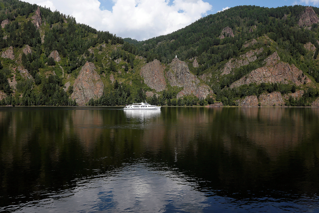 A motor ship sails along the Yenisei river in the Taiga district outside Krasnoyarsk, Siberia, Russia