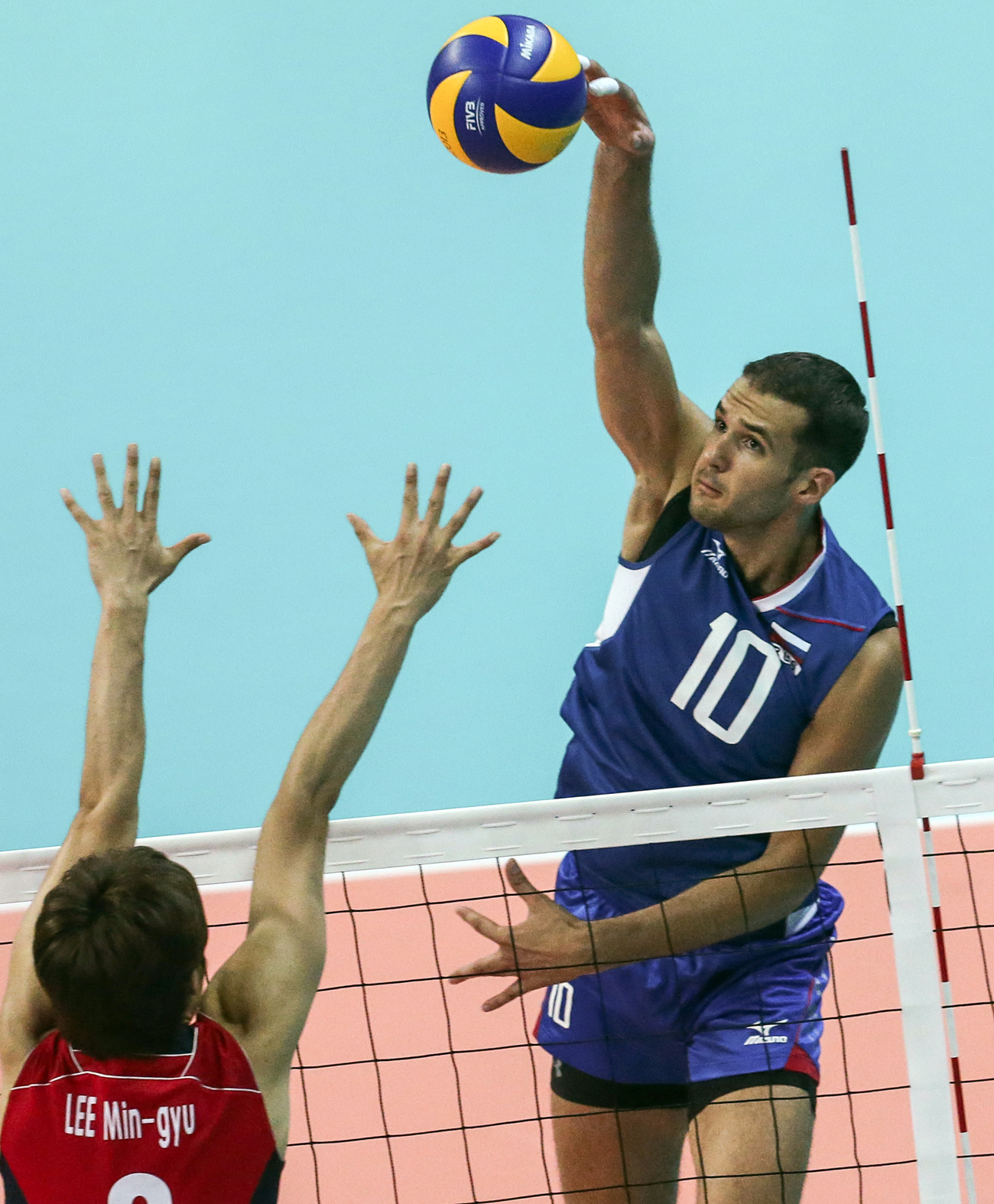 Photo: Alexander Markin (blue) of Russia in the first match of the group stage of the 27th Summer Universiade in 2013.
