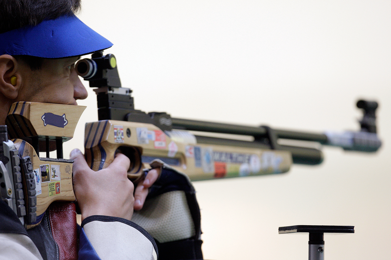 Photo: Russia's Konstantin Prikhodtchenko shoots during Mens 10m Air Rifle final round at Shooting Range Hall at the Beijing 2008 Olympics in Beijing.