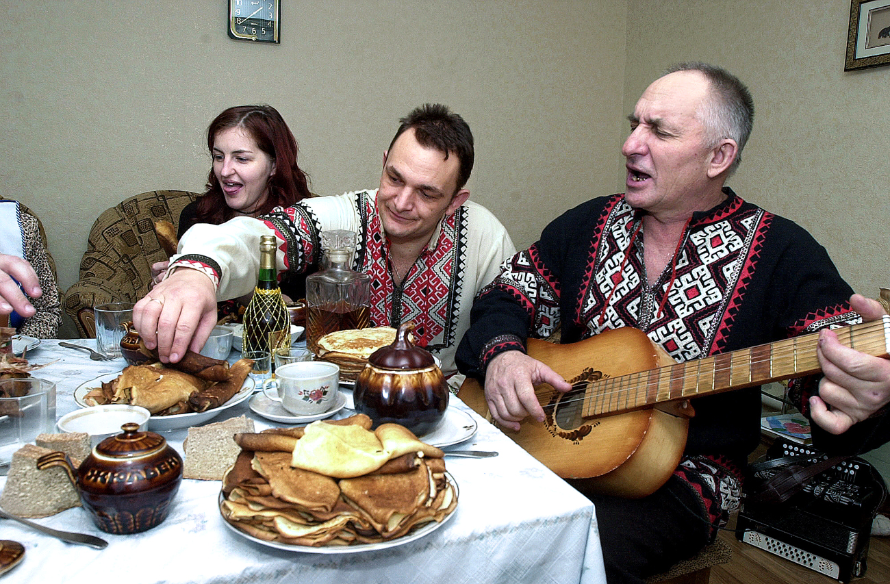 Photo: Smorodino Village (Belgorod region, Russia) peasants celebrate Maslenitsa (Pancake Week). Pancakes or bliny, flat thin cakes made of batter, are traditionally made during week-long Maslenitsa celebrations.