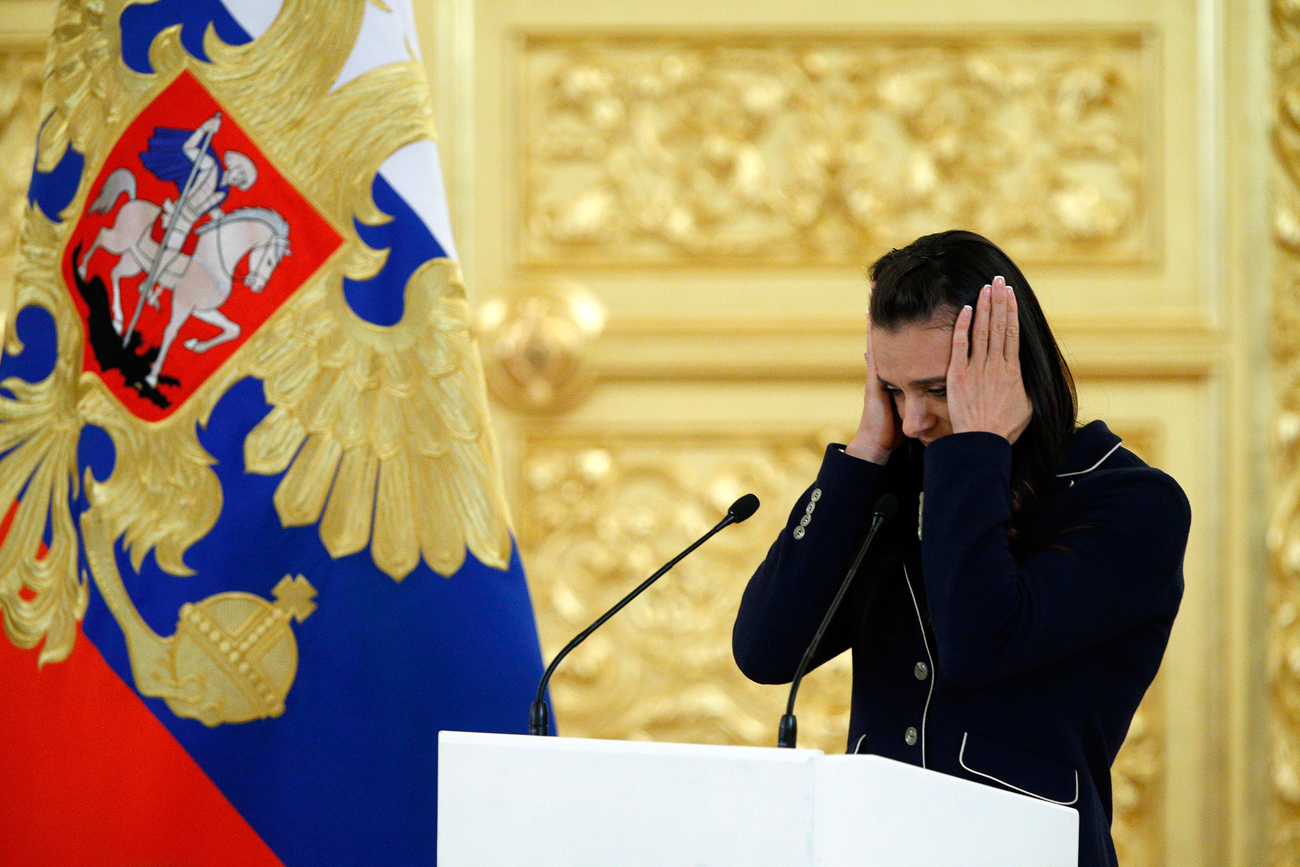 Russia's pole vaulter and Olympic champion Yelena Isinbayeva gestures as she speaks at the Kremlin, in Moscow.