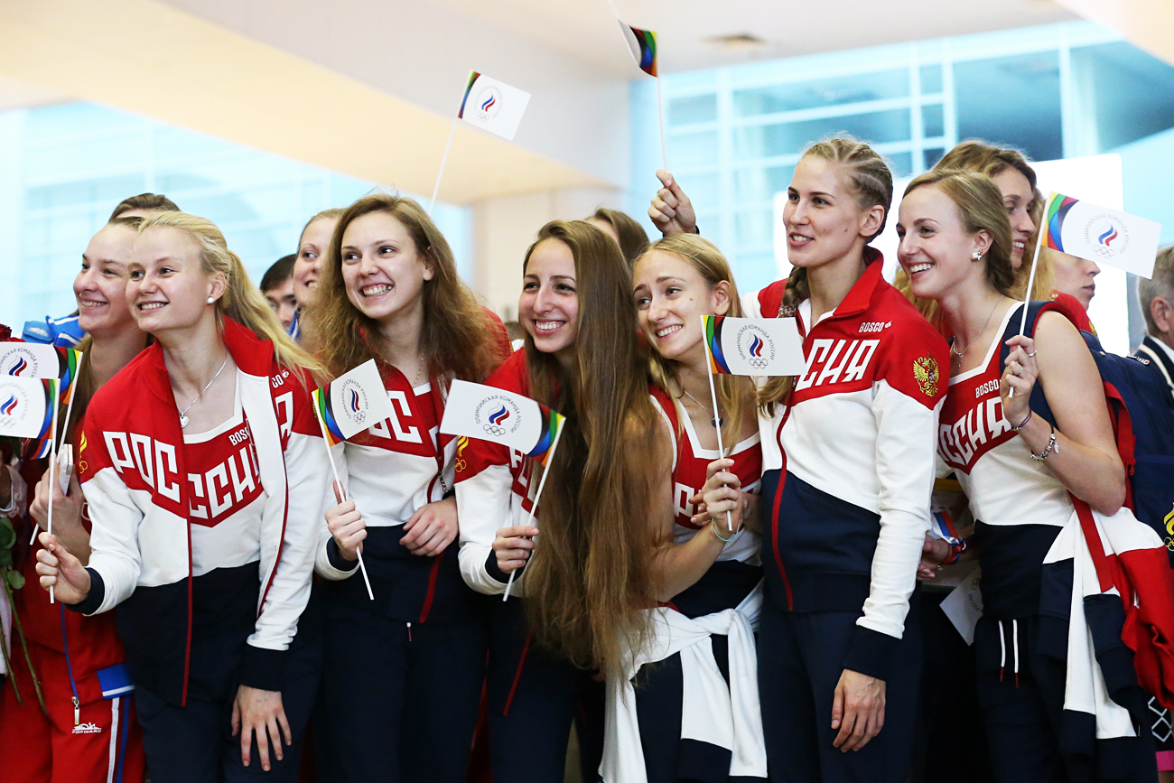 Anastasia Bayandina, Alexandra Patskevich, Svetlana Kolesnichenko, Elena Prokofyeva, Vlada Chigireva, Alla Shishkina and Maria Shurochkina (L-R), members of the Russian synchronized swimming team, at Sheremetyevo International Airport ahead of leaving for the 2016 Summer Olympic Games to be held in Rio de Janeiro, Brazil on August 5-21, 2016.