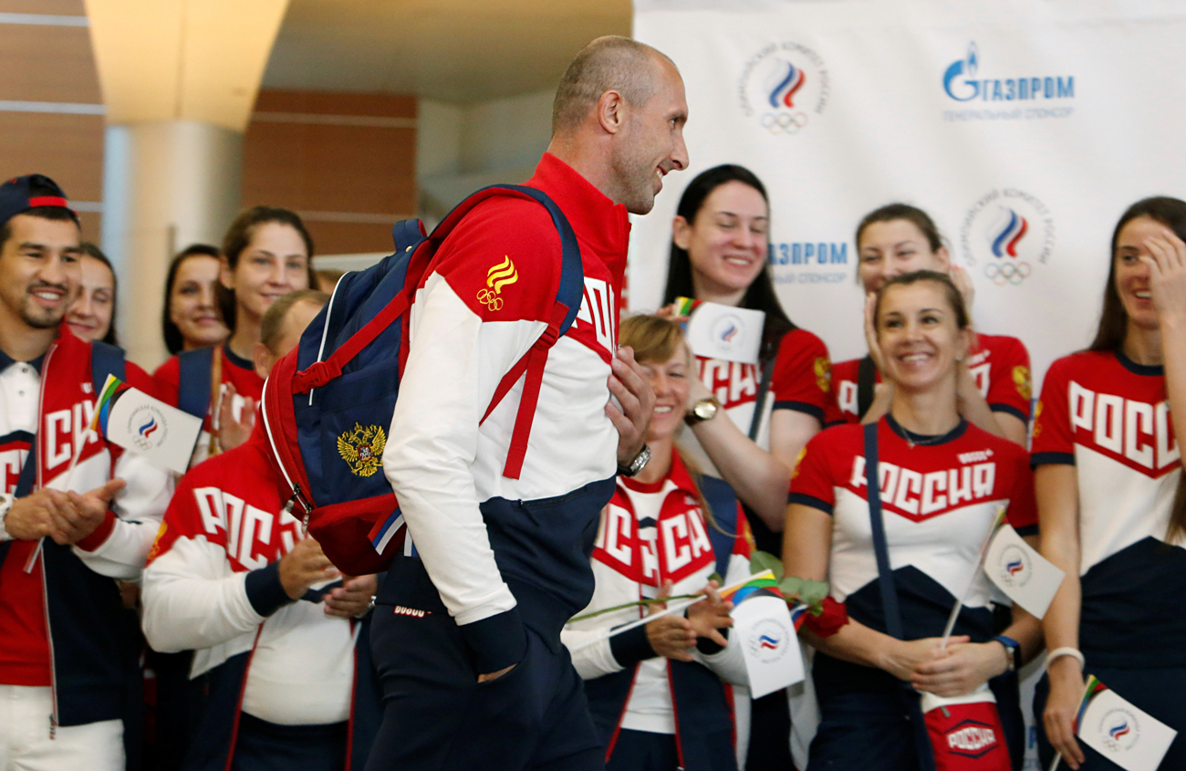Russia men's volleyball Olympic team member Sergey Tetyukhin walks during a farewell ceremony before the national team's departure to 2016 Rio Olympics at Sheremetyevo International Airport outside Moscow, July 28, 2016.