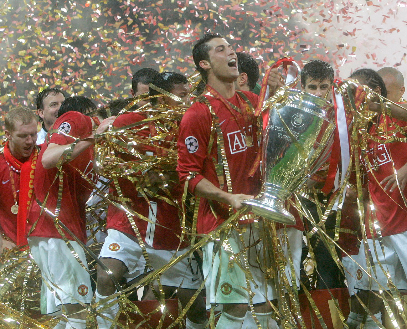 For the 2008 UEFA Champions League final, officials laid out natural grass instead, but shortly after the match they reverted back to the good old artificial carpet. // Manchester United's Cristiano Ronaldo celebrates with the trophy at the end of the Champions League final soccer match at the Luzhniki Stadium in Moscow.