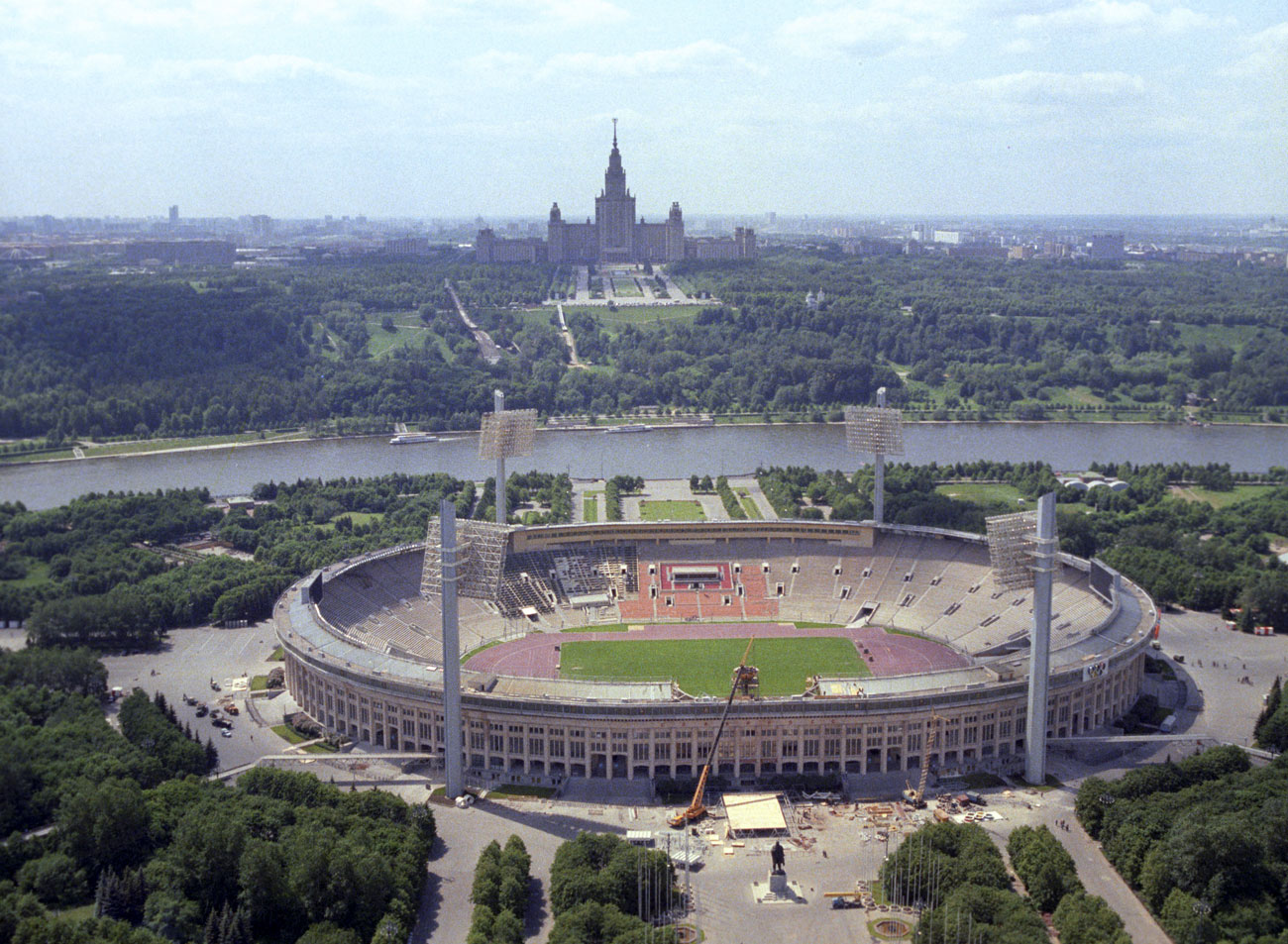 The stadium was placed in a picturesque area beside the Lenin (now Sparrow) Hills and the Main Building of the Moscow State University.