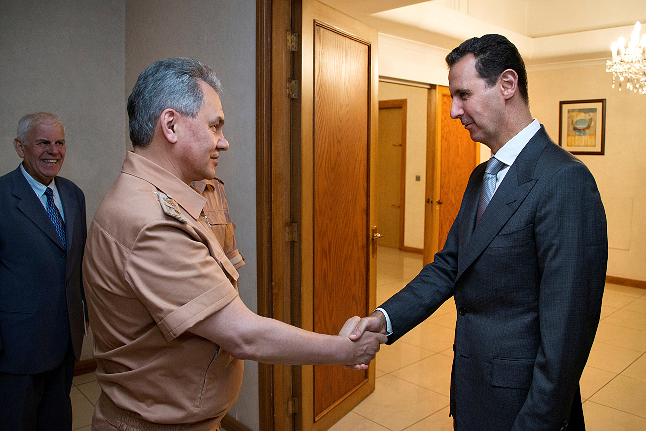 Syria's President Bashar al-Assad shakes hands with Russian Defense Minister Sergei Shoigu in Damascus, Syria, June 18, 2016. Picture taken June 18, 2016