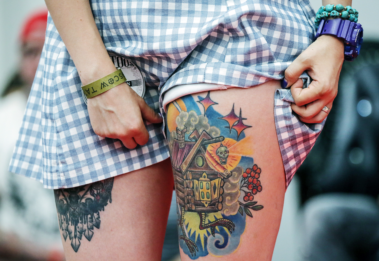 "A participant of the festival Moscow Tattoo Week in the trade and exhibition center ""Tishinka"""