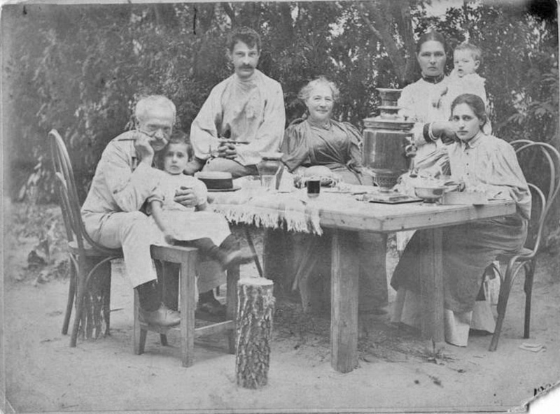 Life in the new Russia required everyone to work, not sit around sipping tea and strolling along leafy paths. / At the dacha: Group portrait, 1896.