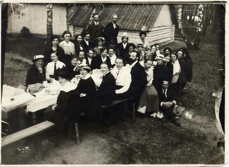 "After World War II, the Soviet government distributed plots of land. They were tiny pieces of land (600 square meters, or 6,500 square feet), commonly known as ""six hundredths."" Dacha owners built small houses on their plots and used the remaining land for subsistence agriculture. / Celebrations at the dacha, 1900s."