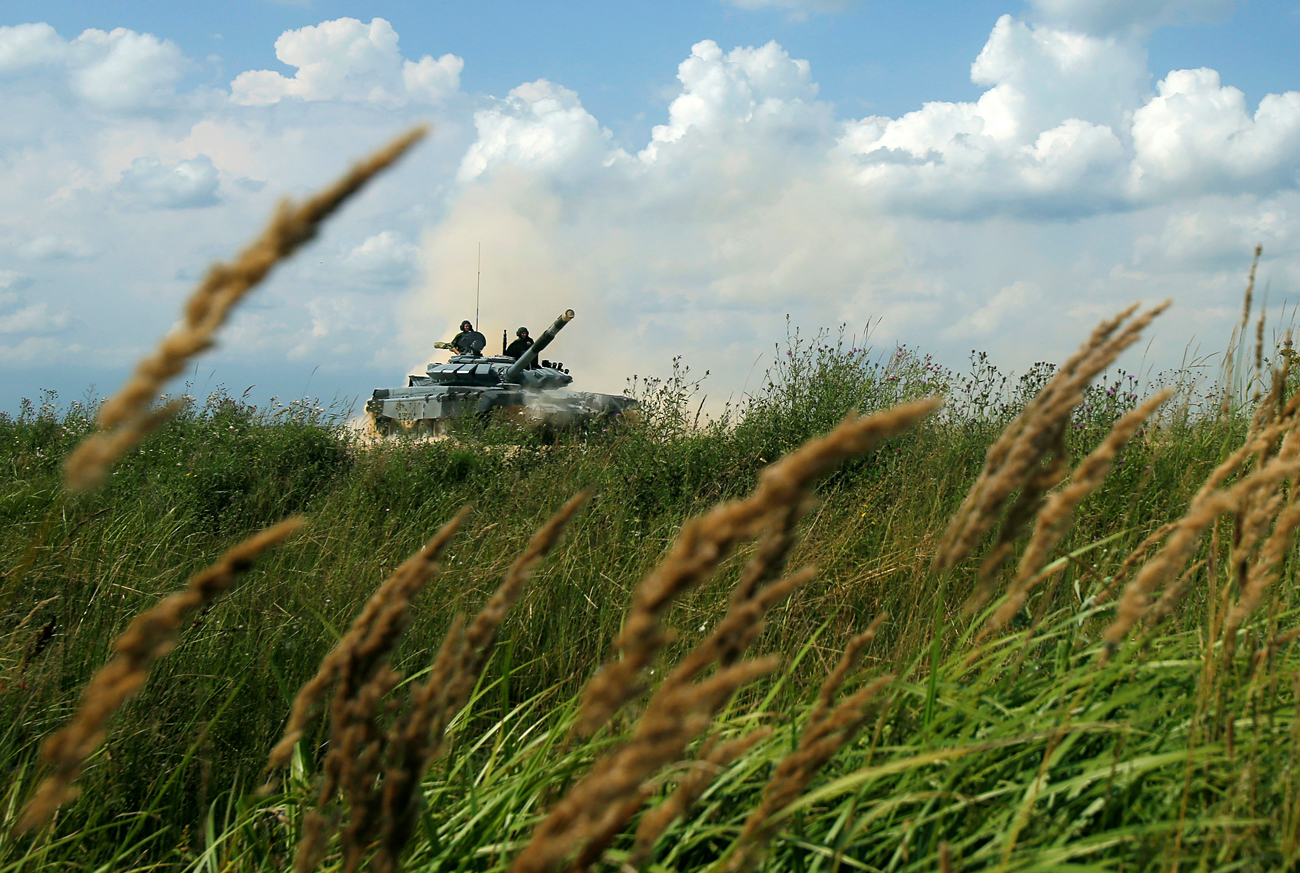 A T-72 tank, operated by a crew from Russia, drives during the Tank Biathlon competition, part of the International Army Games 2016, at a range in the settlement of Alabino outside Moscow, Russia, August 2, 2016