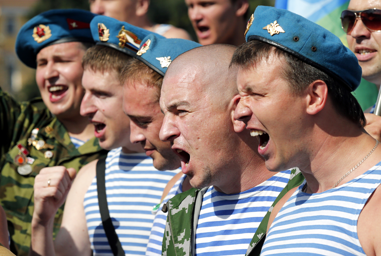 Former Russian paratroopers march and shout slogans during the Russian 'Paratroopers Day' celebrations at Dvortsovaya Square in St. Petersburg.