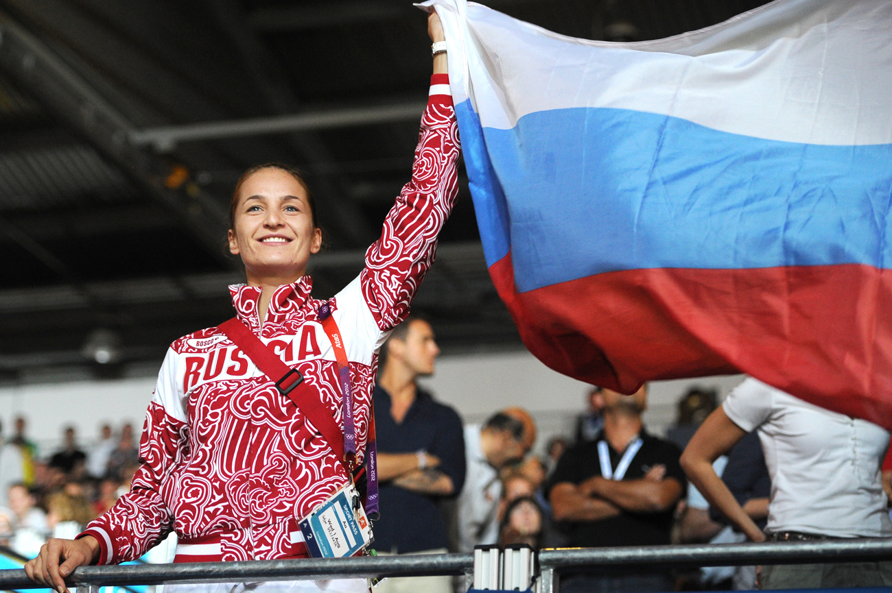 Russia's fencer Sofya Velikaya waves during the medal ceremony for the women's team foil event during the 2012 London Summer Olympic Games.